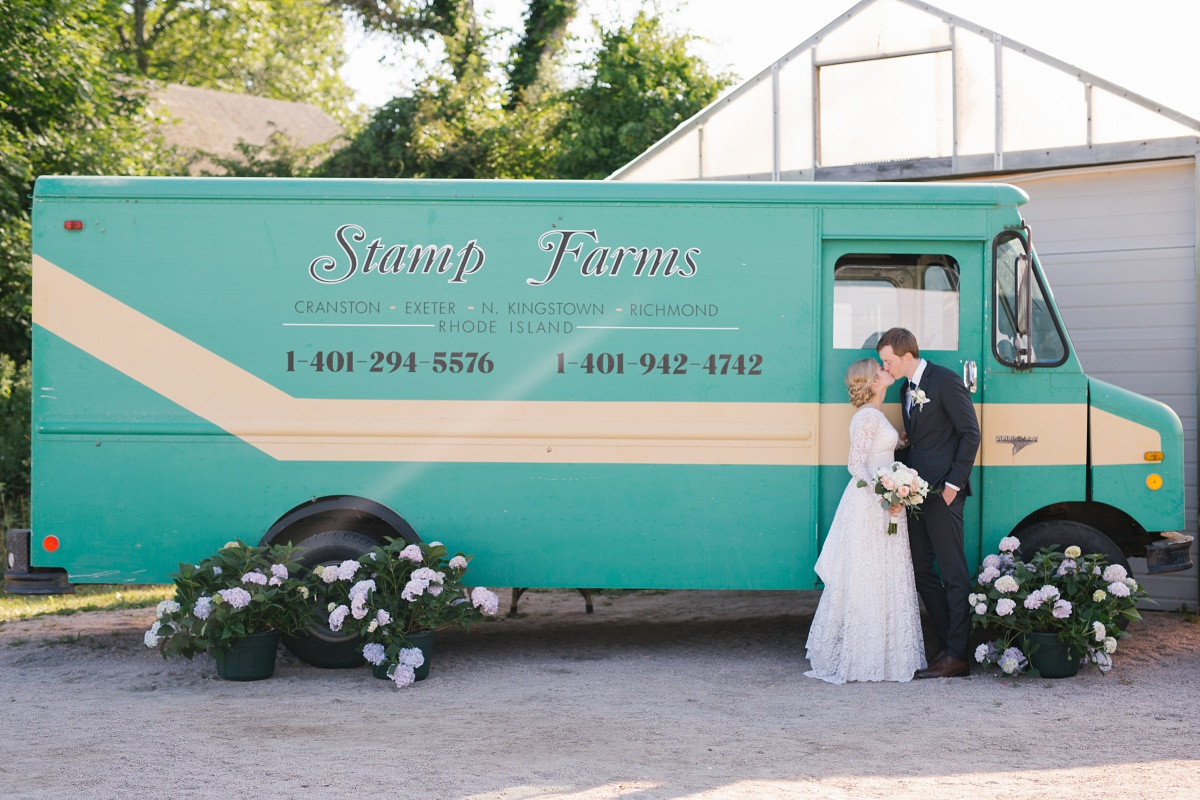 Bride and Groom pose by Stamp Farms truck in Rhode Island