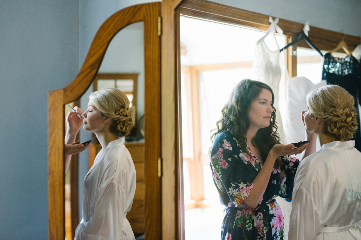 Bride applies her wedding makeup