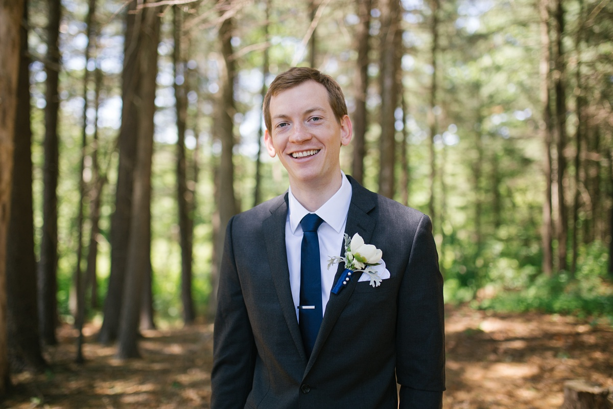 Groom smiles in nature photo