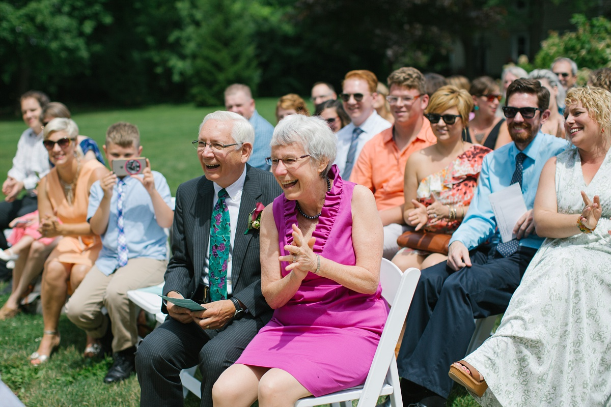Parents of the groom having fun at outdoor wedding ceremony at Hurley Gardens