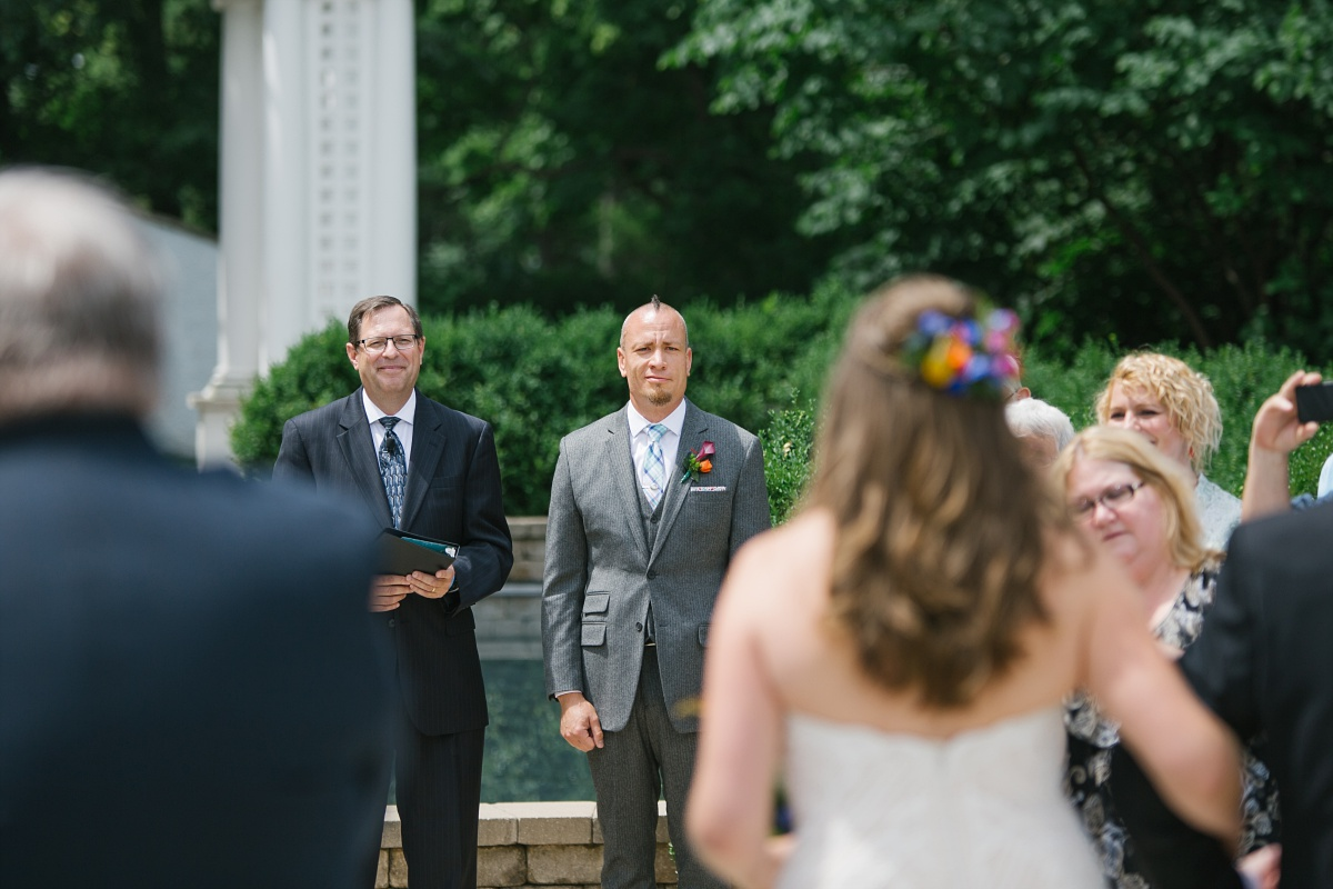 Groom watches his beautiful bride approach