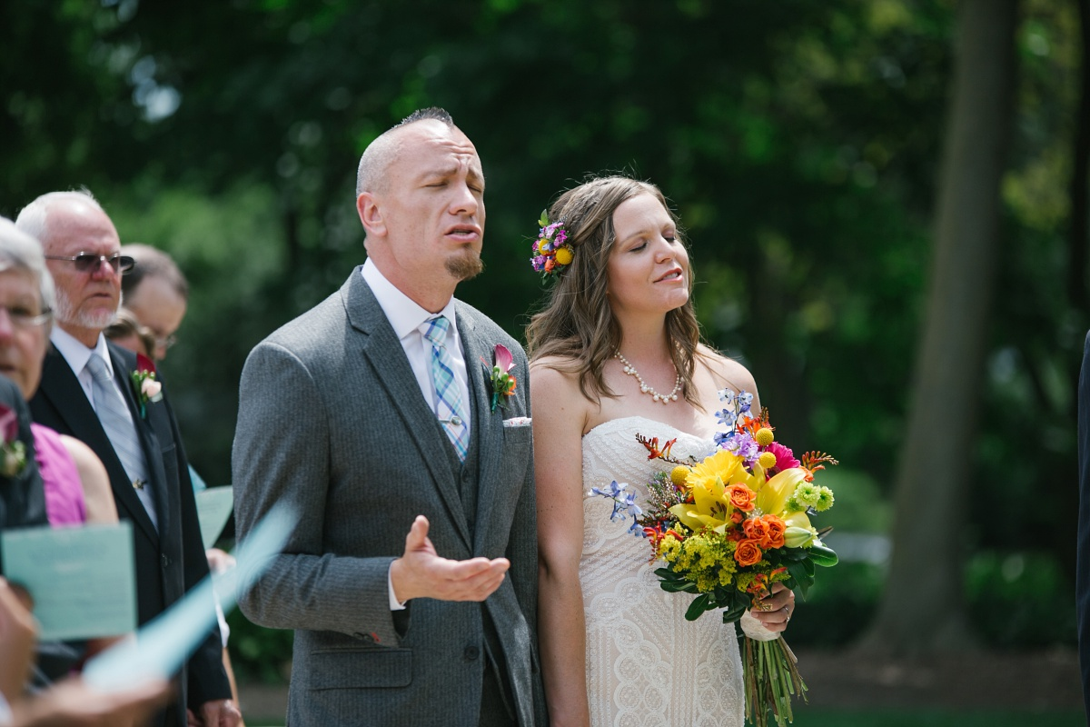 Bride and groom sing together at their Wheaton Wedding