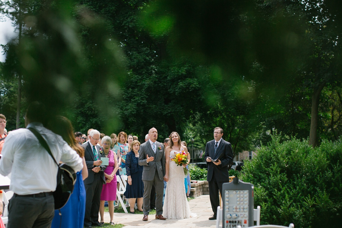 guests and bride and groom singing at the wedding ceremony