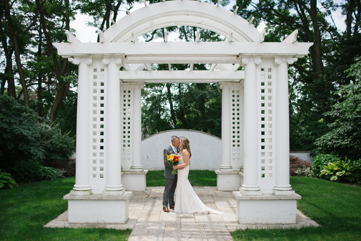 Couple kiss at their Hurley Gardens Wedding in Wheaton, IL