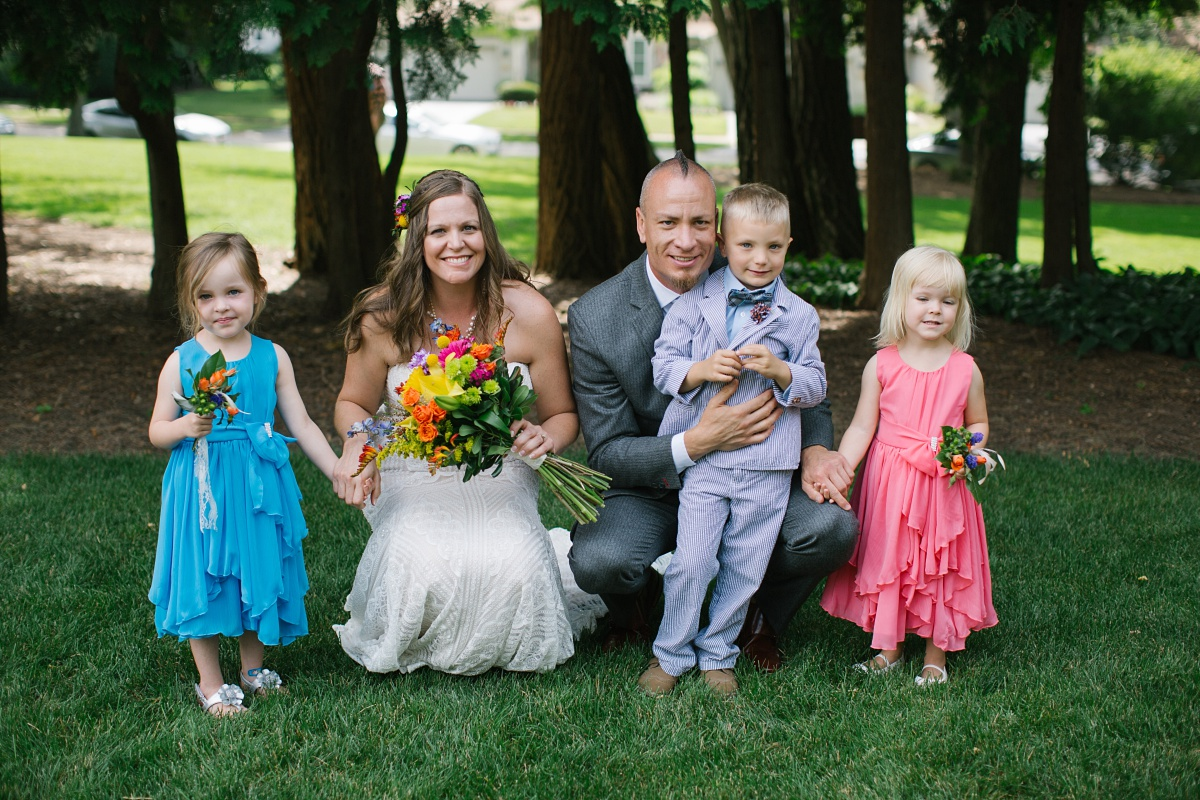 Bride, groom, and children dressed in bright pastels at Hurley Gardens wedding