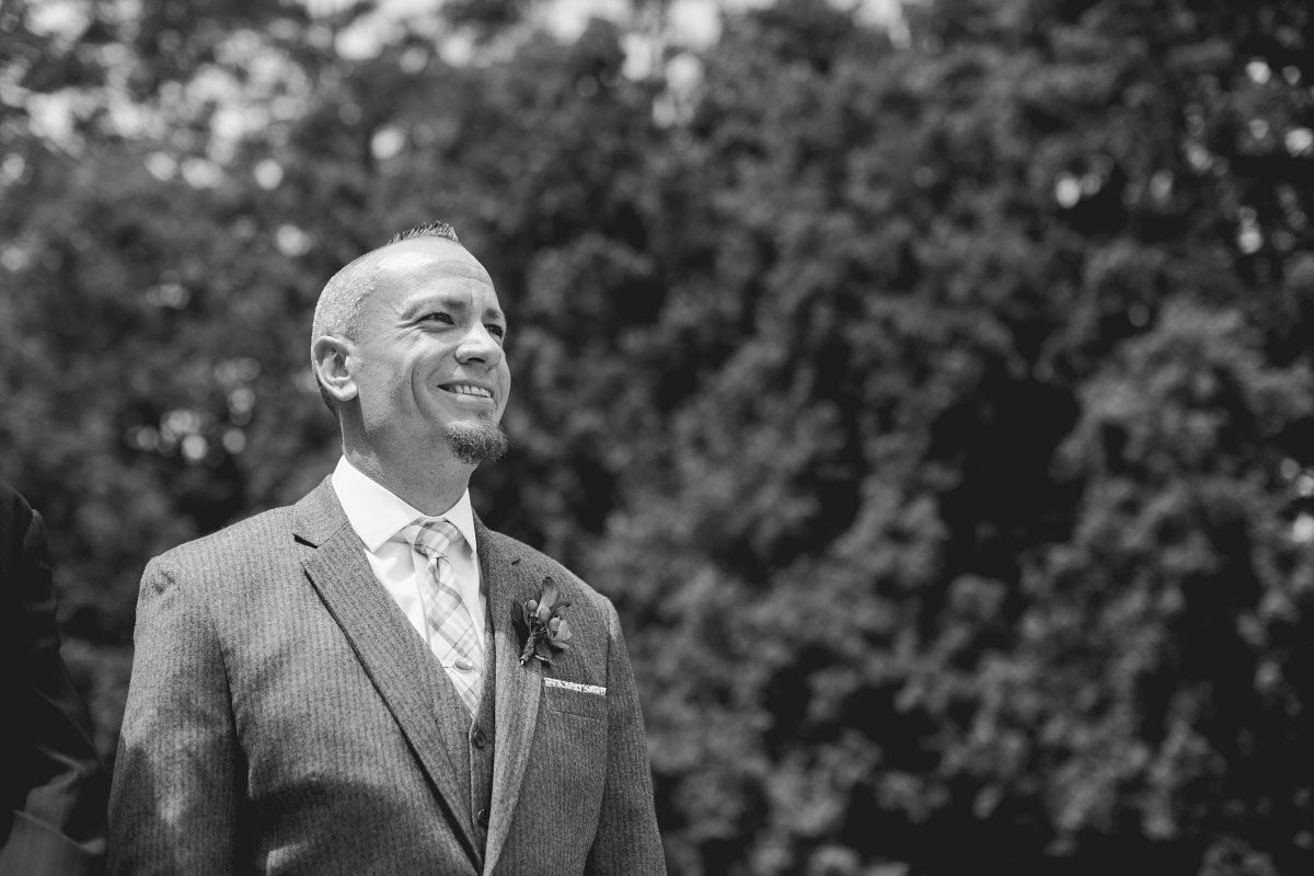 Groom smiles with excitement at Hurley Gardens