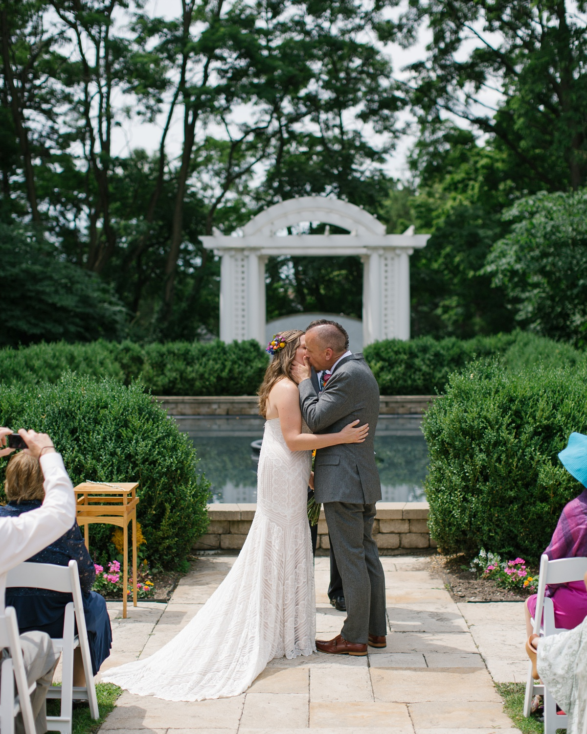 Bride and Groom kiss at their garden ceremony