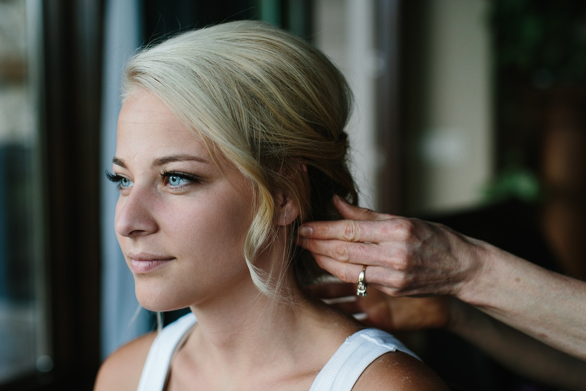 Blonde bride gets hair done and adds curl