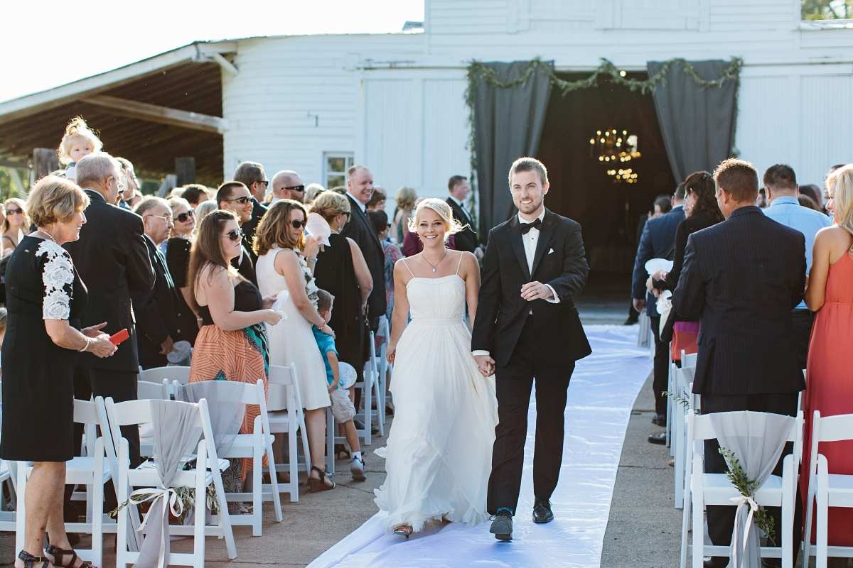 Bride and groom walk down the aisle as man and wife