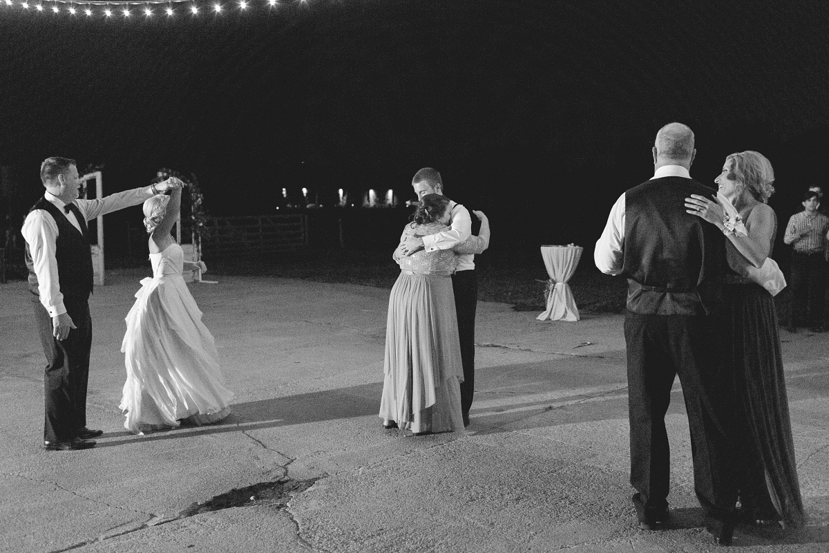 Mother of groom dances with her son and Father of the bride dances with his daughter