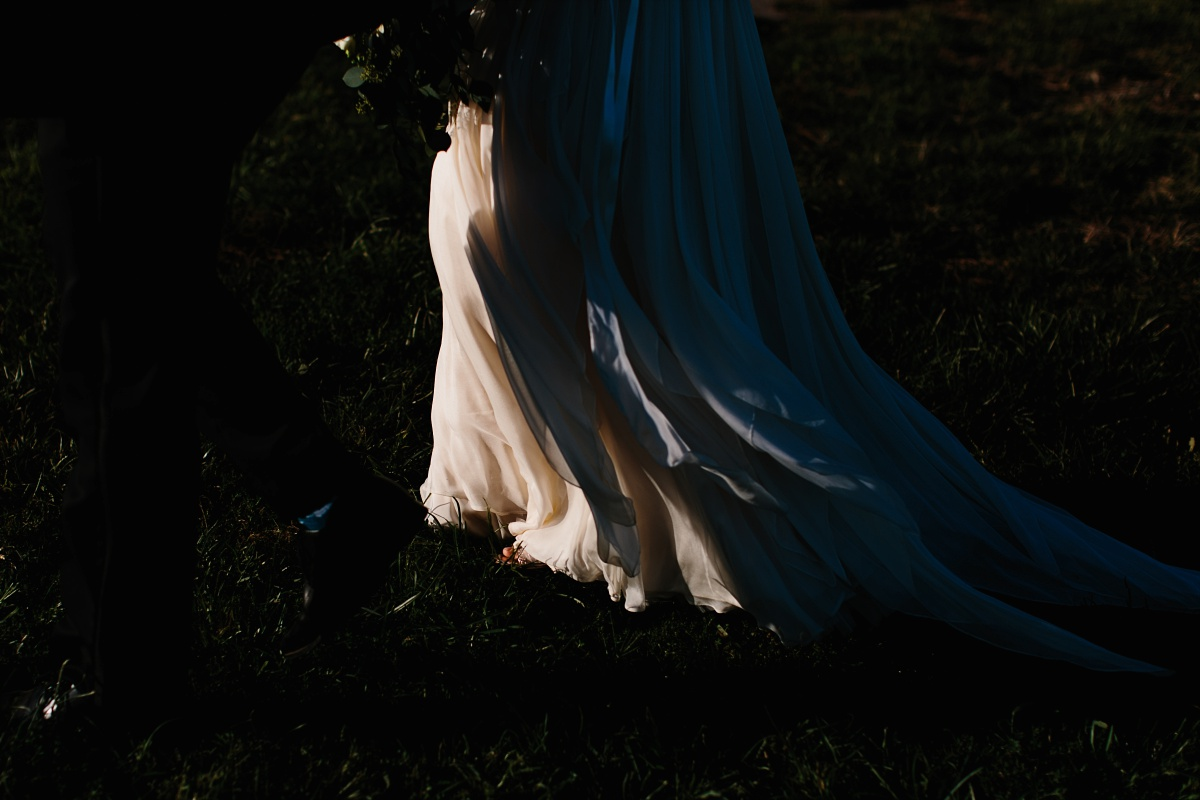 Picture of wedding dress train in the shadows