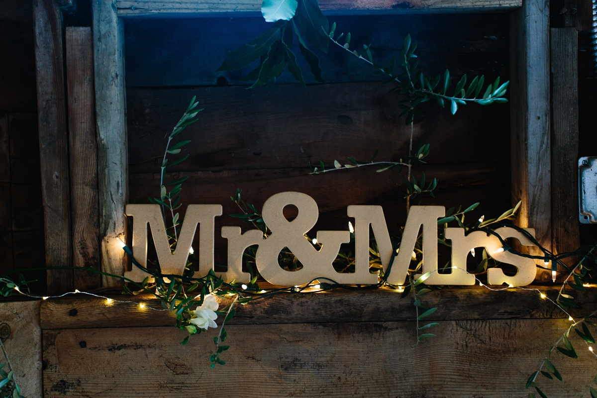 Mr & Mrs sign in greenery and lighting