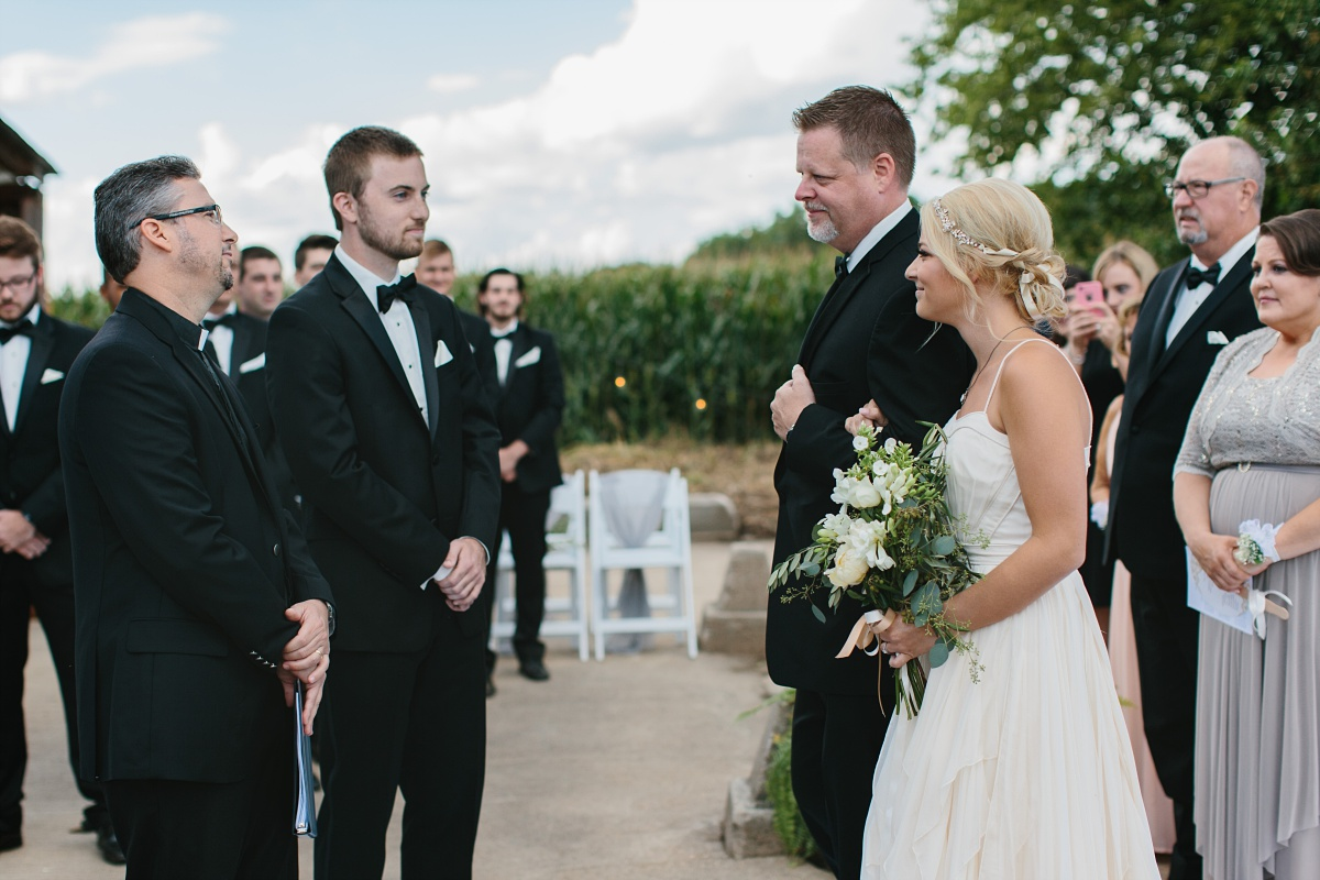 Bride, groom, father, and pastor meet at the altar