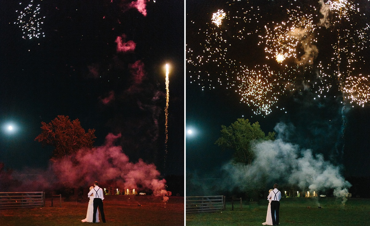 Bride and groom watch their red and gold fireworks together