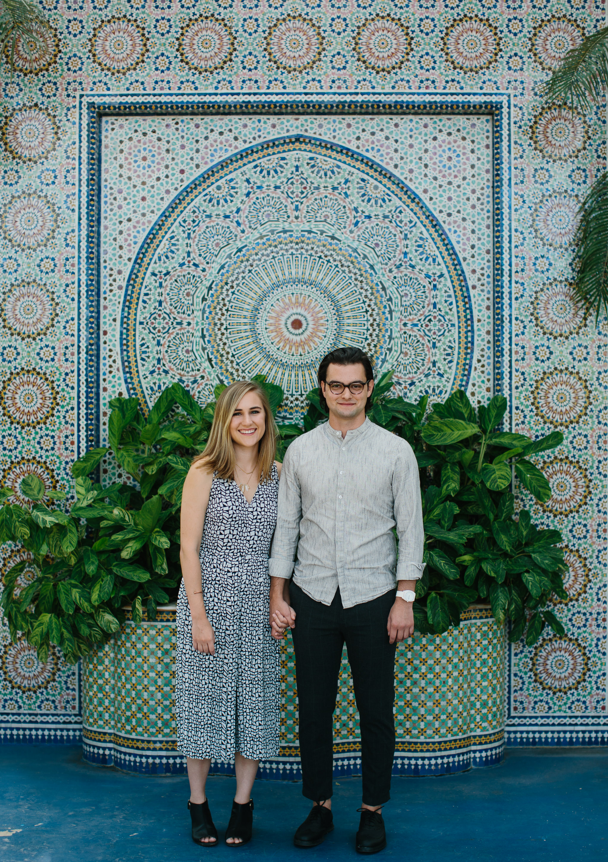 Engaged couple take photos at Garfield Park Conservatory