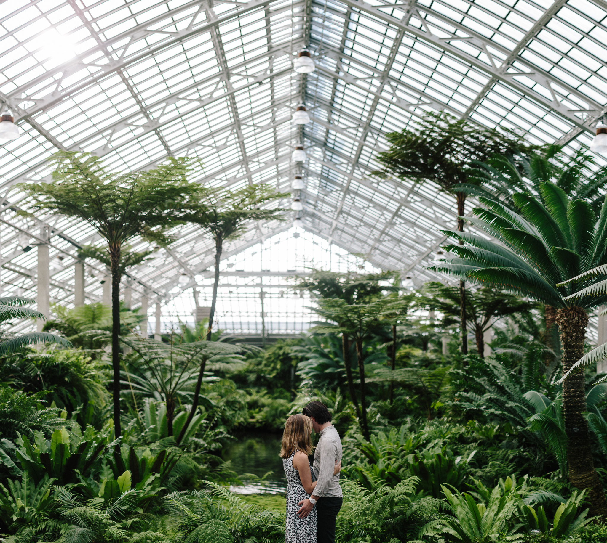 Engaged couple photo shoot in the fern house at conservatory