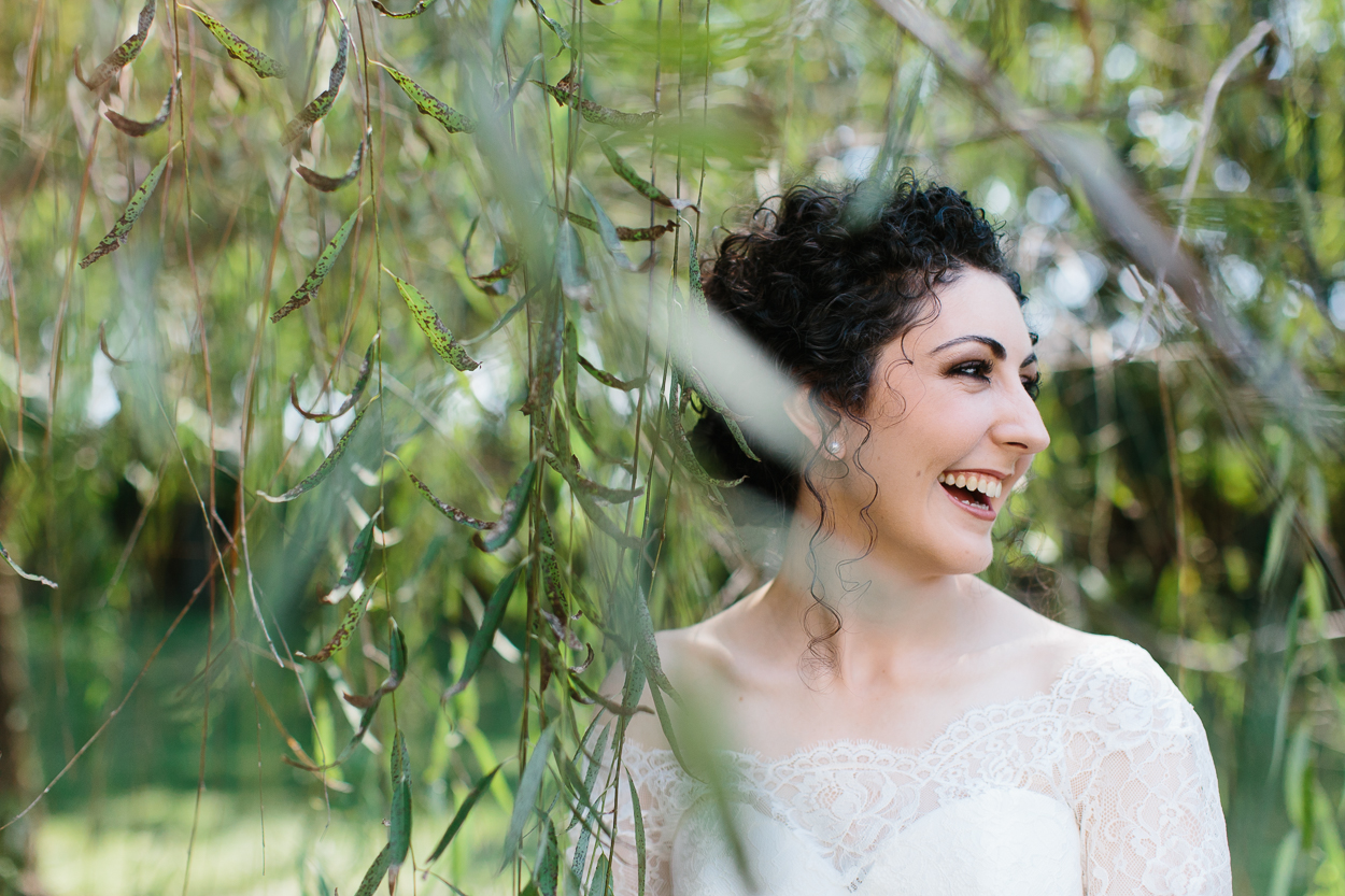close up of Nashville wedding bride in the trees