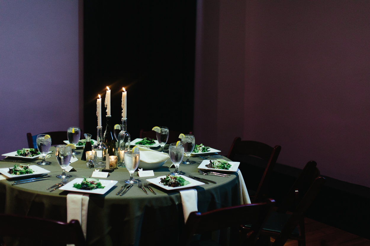Wedding dining table with green tablecloth