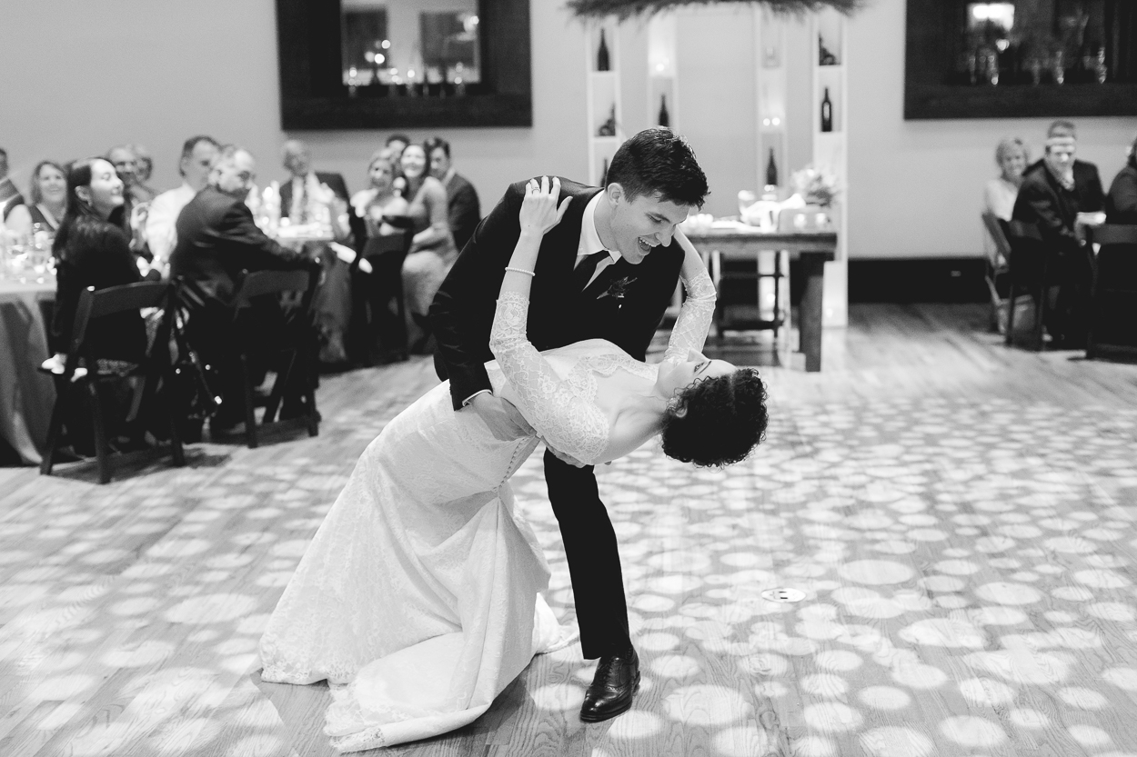 Groom dances with bride at Bell Tower