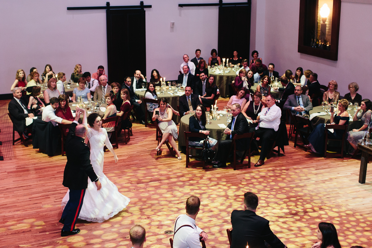 bride and groom twirl and dance on ballroom floor of Bell Tower