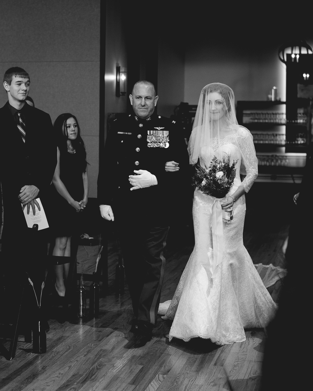 decorated father walks daughter down the aisle at her Bell Tower wedding