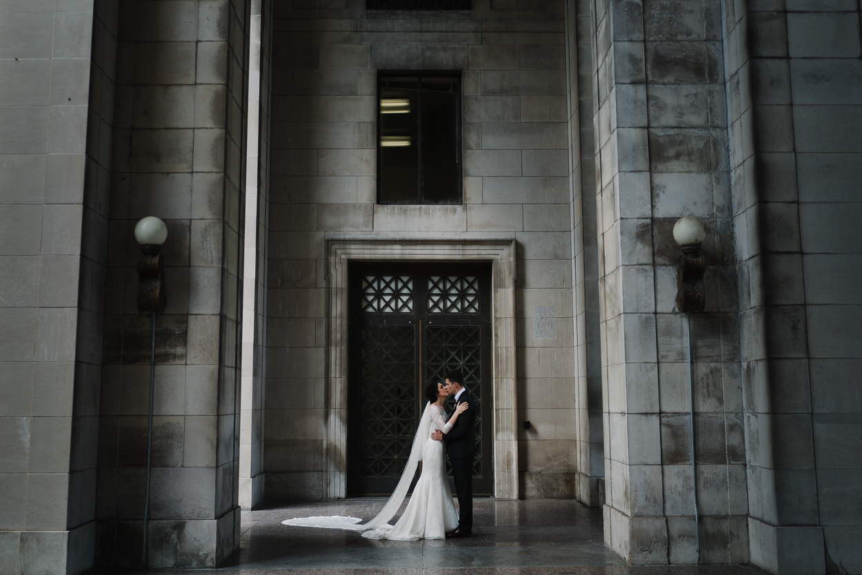 Bride and Groom kiss in front of the Legislative Plaza