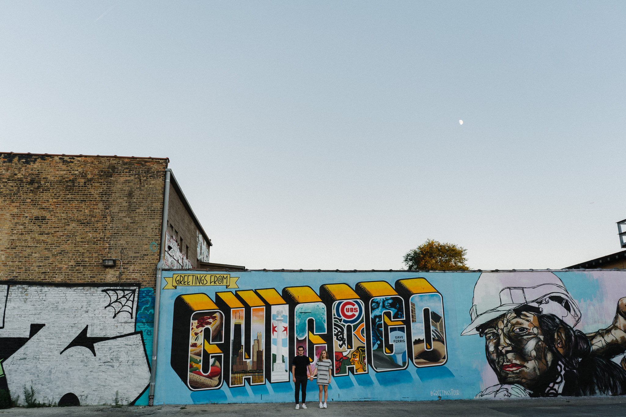 Engagement photo shoot in front of Chicago Mural