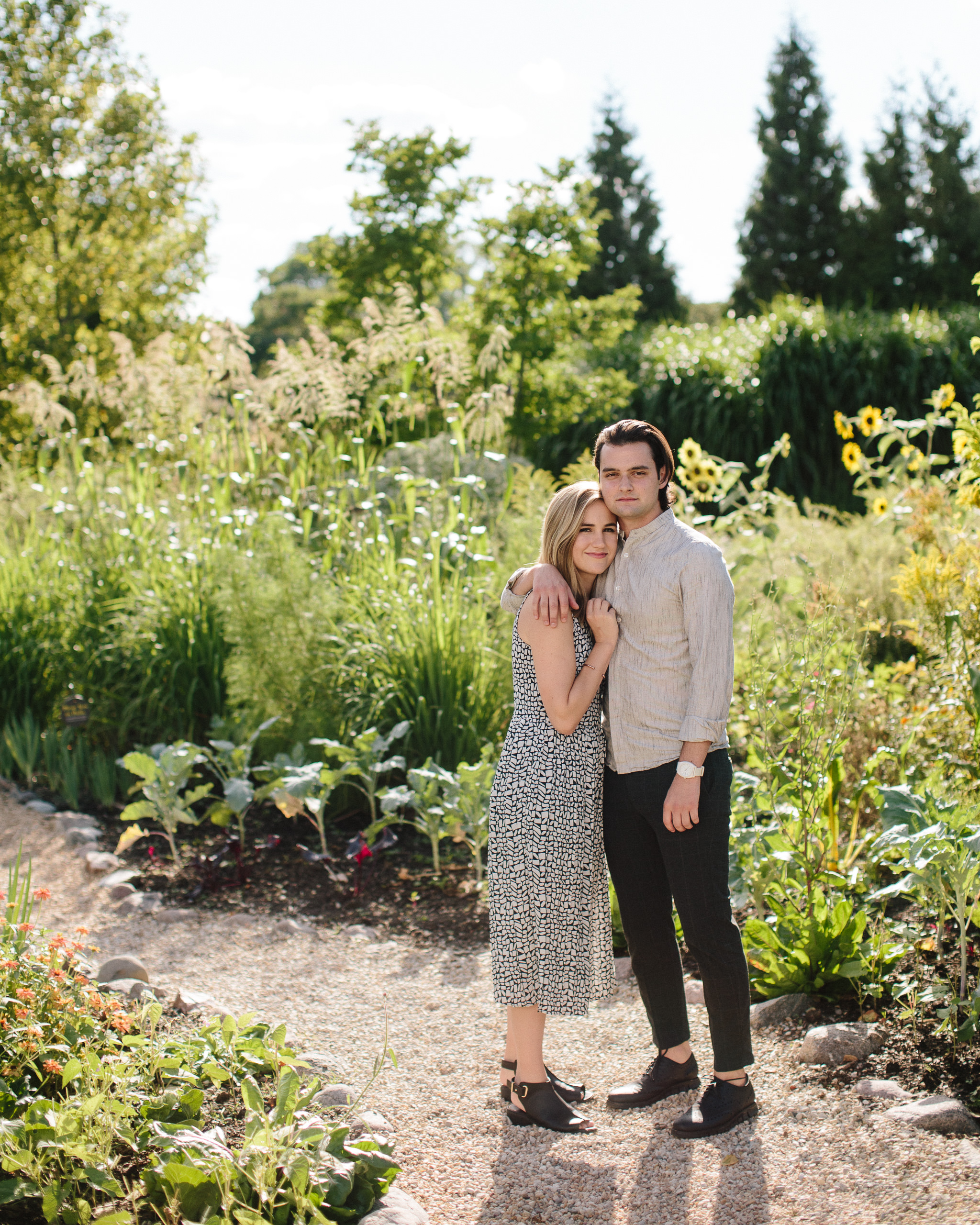 Engagement pictures with sunflowers outside the Garfield Park Conservatory